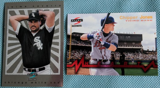 Inserts pulled from 1997 Score Hobby Reserve packs included a well-designed Reserve Collection (left) parallel of Jamie Navarro and a Heart of the Order of Chipper Jones.