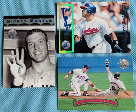 Two packs of 1996 Stadium Club yielded a Mickey Mantle insert card, a short-print TSC subset of Albert Belle, and an action shot of a young Chipper Jones, now a Hall of Famer.