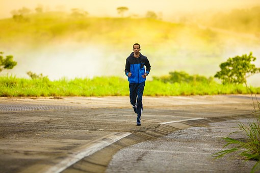 A man jogging to loss weight, for strength, fitness, and endurance
