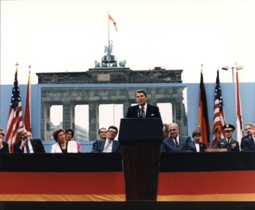"Ronald Reagan speaking in front of the Brandenburg Gate: ""Come here to this gate! Mr. Gorbachev, open this gate! Mr. Gorbachev, tear down this wall!"" (courtesy of Wikimedia Commons)"
