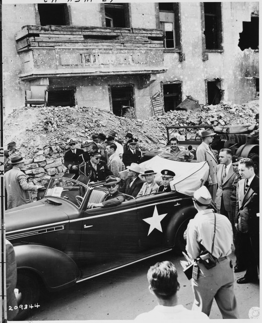 L to R in rear seat of car: President Harry S. Truman, Secretary of State James Byrnes, and Fleet Admiral William Leahy inspect the ruins of Hitler's Chancellery in Berlin, Germany. President Truman is in Germany to attend the Potsdam Conference.