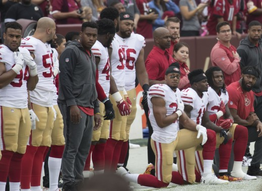 Members of the San Francisco 49ers kneeling during the National Anthem - 2017