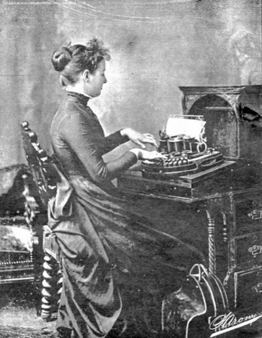 A woman operating a typewriter