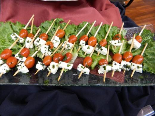 Cherry tomatoes and squares of cheese on a tiny skewer make a great appetizer.