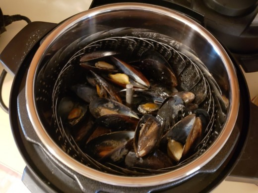you can use the steamer basket if you prefer not letting them cook in the liquid, but it won't change the taste or flavor.