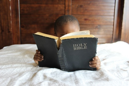 A child reading the bible