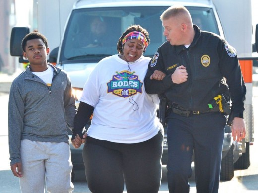 Police Officer Aubrey Gregory walks with Asia Ford as she participates in the Rodes