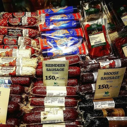 Tubes of reindeer sausage stacked against moose sausage.