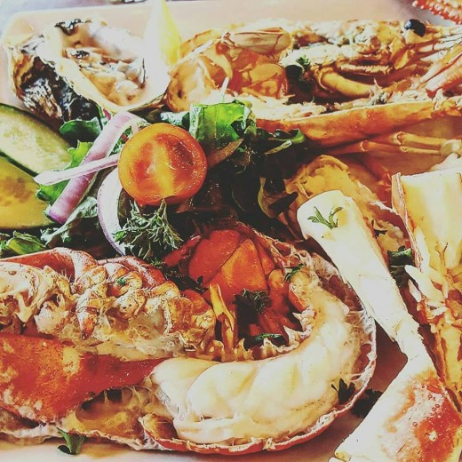 A seafood platter filled with Norwegian lobster, prawns and oysters.