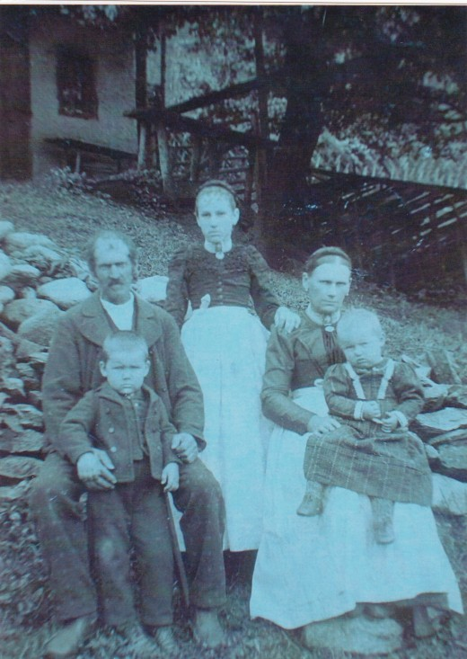 My paternal grandma at about age of 13 in Austria around 1890. She is with her father, step-mother, and half-sister and half-brother.