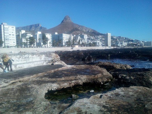 I live in Sea Point. It is an expensive area, and just down the road from me, an area was taken from people of colour. It has been rebuilt and now has some of the most expensive real estate in the area.