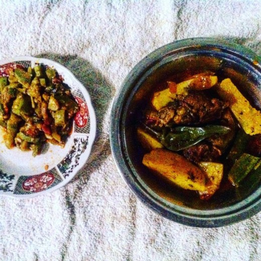 A neighbor brought me lunch when I was sick.  Pictured is a potato and meat tajine next to a plate of spiced vegetables.