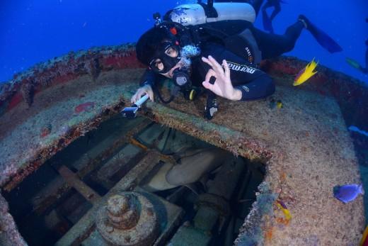 Scuba diver accessing a wreck
