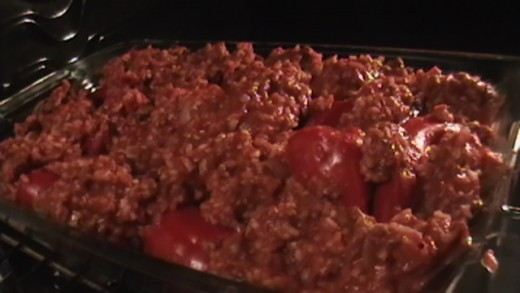 Stuff the red peppers with the mixture and lay evenly in a baking dish. Spread extra mixture evenly in baking dish.