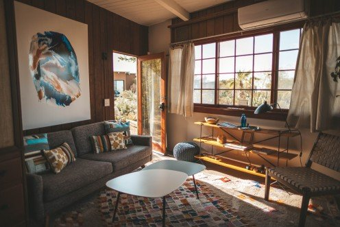 An eclectic room has a variety of funky and stylish elements.