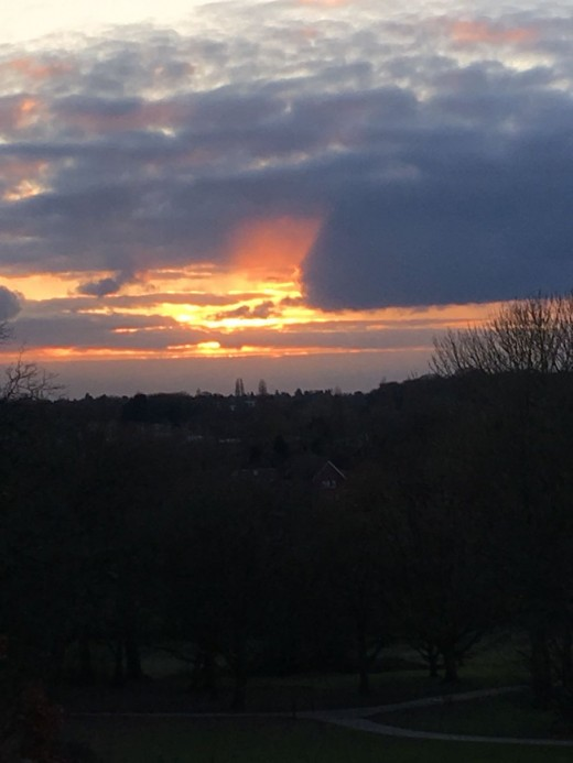 A photograph taken of the view from Elmdon Park Hill at sunset.
