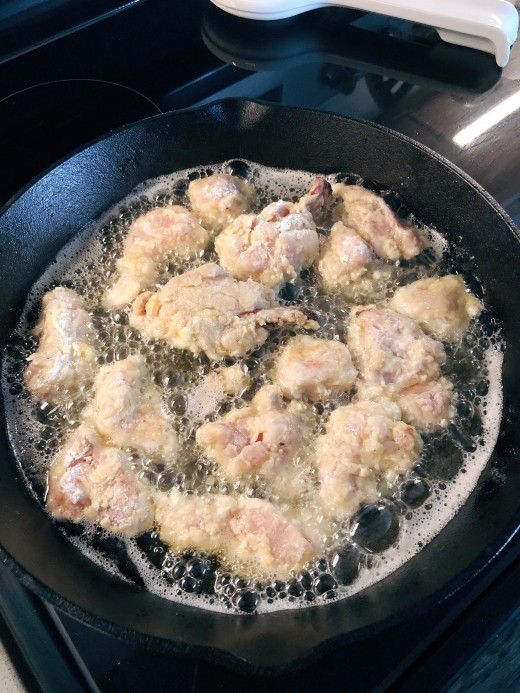 Frying the chicken.