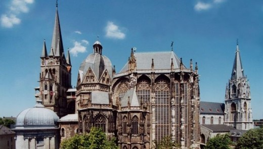 Aachen Cathedral or Achener Dom, also known as the Cathedral of Aix-la-Chapelle. Its construction began in the 8th century under Emperor Charlemagne and was consecrated in 805 CE.
