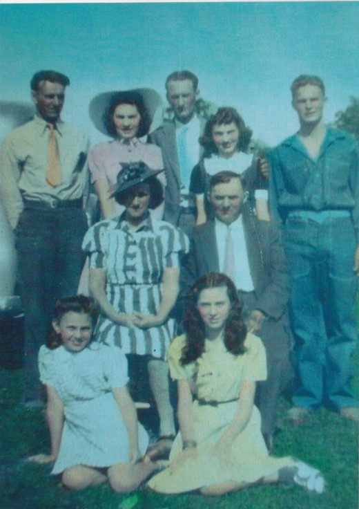 Standing from left to right:  dad, aunt Marie, uncle Augie, aunt Laura, and uncle Dick.  Seated are grandma and grandpa.  Seated in front are aunt Florence and aunt Helen