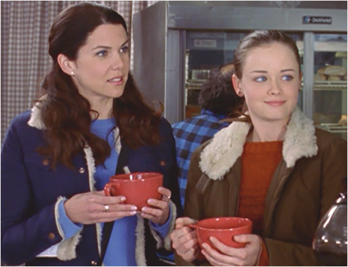 Alexis Bledel (Rory) was actually drinking Coca-Cola, not coffee.