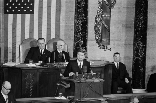 President John F. Kennedy delivering his 1963 State of the Union address in which he proposes tax cuts to spur economic growth