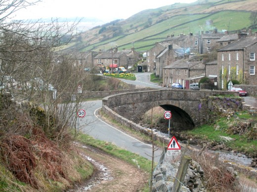 Muker village - there's a car park on the left before the bridge, and buses stop across the bridge. Parking is also possible on the left side of the road if there aren't too many others (weekdays)