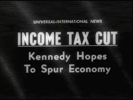 Television thematic display preceding President Kennedy's address to the nation on tax cuts on September 18, 1963