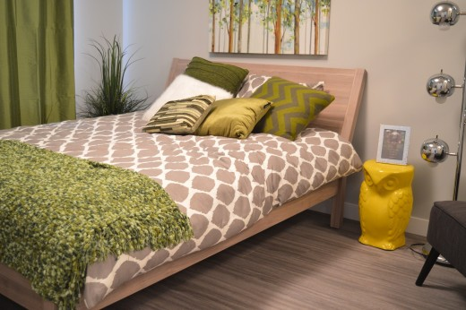 The colors of the pillows, the texture of the bedspread, and other decorator accessories add colorful accents to highlight the identity of the bedroom.