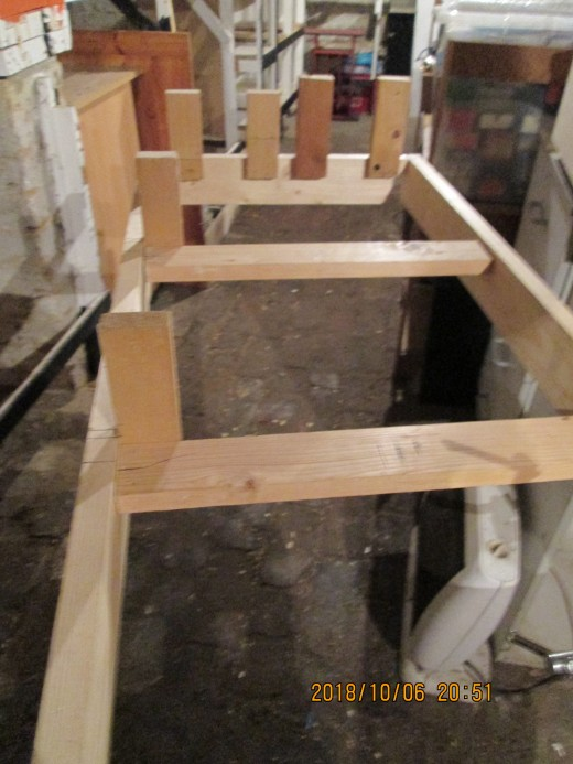The view from behind shows how the risers are attached at the 'meeting' end (the breadth of 2 X 1 inch planed), made easier by clamping lengths of 2 X 1 under the stretchers to keep the board level