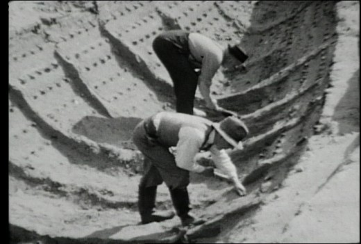 1939 photo of Sutton Hoo burial ship being excavated. The boat's timbers had rotted away leaving a ghostly imprint in the sandy soil.