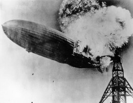 Explosion of the air passenger Zeppelin the Hindenburg at Lakehurst, New Jersey on May 6, 1937 (Source: Public Domain photo taken by U.S. Navy photographer on duty at time.  Courtesy of WikiPedia Commons)