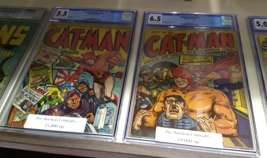 Two early issues of Cat-Man, a 1940s knock-off of Bat-Man. No relation to the current DC Comics' character Catman.