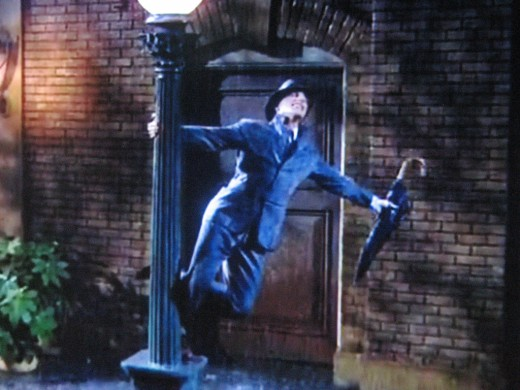 The signature scene from 'Singin' In The Rain' has passed into pop culture history, inspiring imitation and parody.
