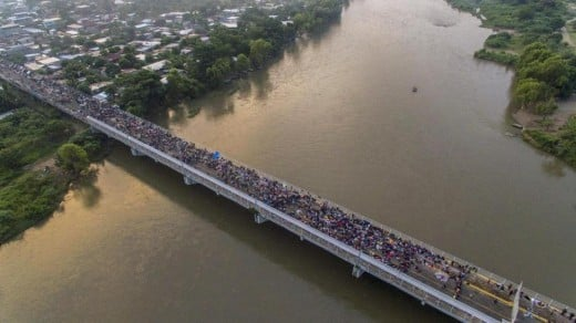 The caravan is contained on a bridge between Guatemala and Mexico