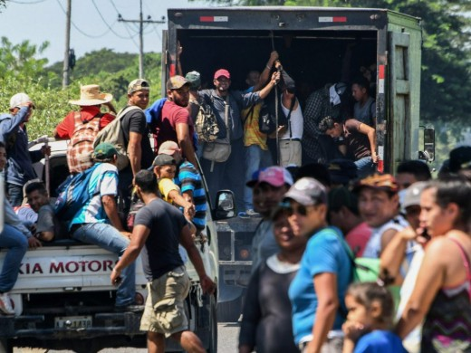 Caravan participants are shown receiving support from an unknown source.