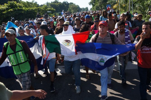 Mexican and Honduran marchers holding flags