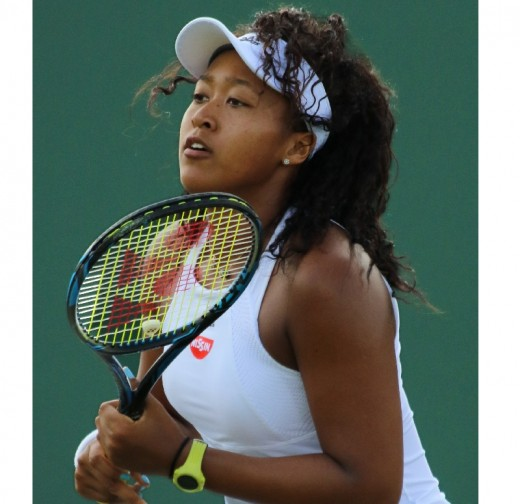 Naomi Osaka playing at Wimbledon in 2017. In 2018 she beat Serena Williams to win the US Open.