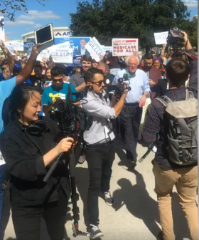 Bernie Sanders marching to polls with students in Florida last week.