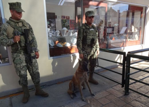 Armed Border Patrol soldiers are stationed at the port to ensure that rules are followed. Identification is required to return to the cruise ship.