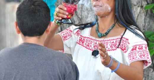 Curandera Performing Ritual on Young Man