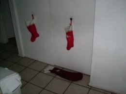 Lacking a fireplace with a mantel, stockings are hung on the door or placed neatly on the floor.