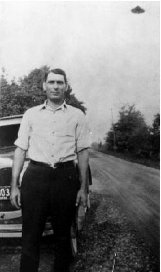George Sutton in St. Paris in Northwestern Ohio with UFO in background in 1932.