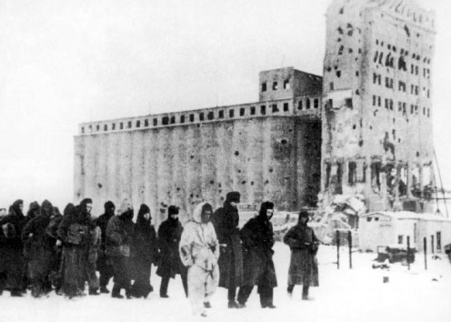 German soldiers as prisoners of war in February 1943. In the background is the heavily fought-over Stalingrad grain elevator.