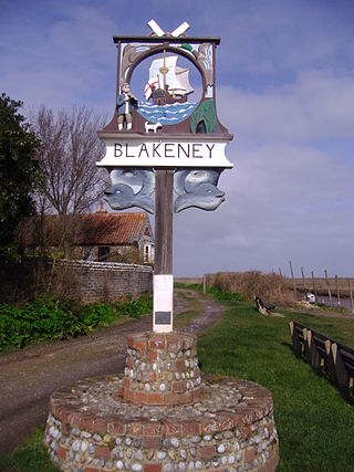 The village sign at Blakeney, literally a stone's throw from the cabin that we stayed in.  Source: Stavros1 via Wikimedia Commons