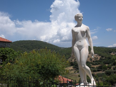 Female Statue, as I was walking down the lane in a small village in Greece. Wish I knew the story behind it.