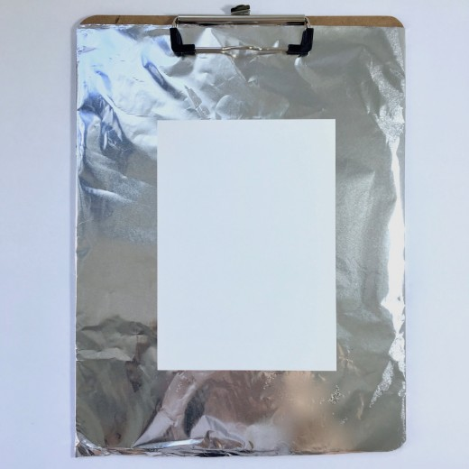 Yupo Paper taped to a clipboard covered in foil gives a flat, stable surface to work on.