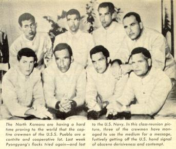 USS Pueblo sailors in captivity.  Some are descretely showing signs of discontent.