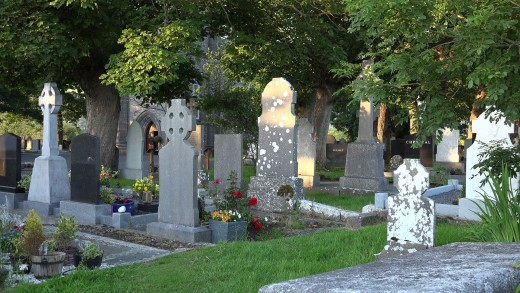 A peaceful evening view of tombstones in the Drumcliff cemetery where Yeats is buried