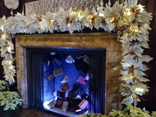 The ornate fireplace in the Music Room.  The poinsettia lace around the mantel is actually composed of pages from books.  What creative people!