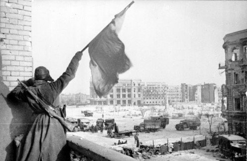 A Red Army soldier raising the flag over Stalingrad after the surrender of German forces February 1942.
